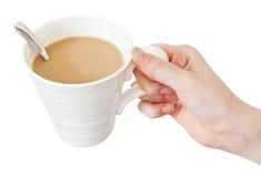 Ręka chwytów kubek kawa z mlekiem Obrazy Stock