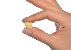 Ręka chwyta SIM mikro nano karta Obraz Royalty Free