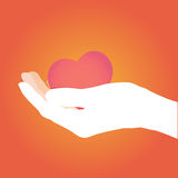 Ręka daje czerwonemu sercu Fotografia Royalty Free