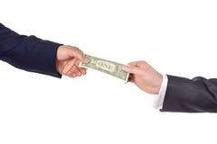 Ręka daje dolarowi Fotografia Royalty Free