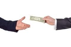 Ręka daje dolarowi Obrazy Royalty Free