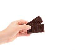Ręka trzyma czekoladowych bary. Obraz Royalty Free