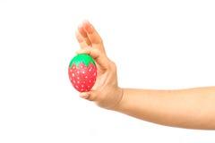 Ręka trzyma Easter jajko Zdjęcia Stock