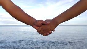Ręka trzyma wpólnie Fotografia Stock