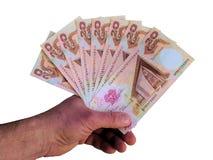 Ręka z banknotami Papua - nowa gwinea. Obrazy Royalty Free