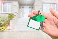 Ręka z domu kluczem Zdjęcia Stock