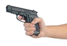 Ręka z pistoletem, odosobnionym na bielu Zdjęcia Royalty Free