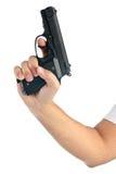 Ręka z pistoletem, odosobnionym na bielu Obraz Royalty Free