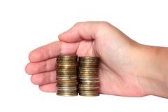 Ręka zakrywa monetarne savings monety Zdjęcia Stock