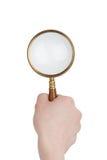 ręki magnifier Zdjęcie Royalty Free