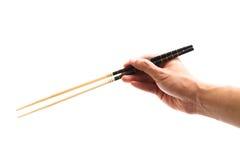 Ręki mienia chopsticks Zdjęcia Royalty Free