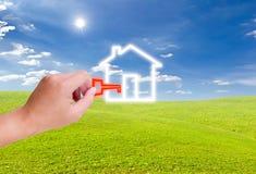 ręki mienia domu ikony klucz Fotografia Stock