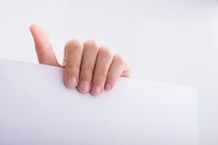 Ręki mienia papier Obrazy Stock