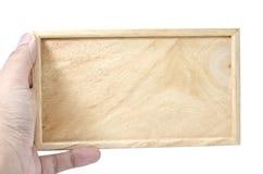 Ręki mienia równina drewniana Zdjęcia Stock