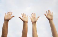 ręki podnosili wpólnie Fotografia Royalty Free