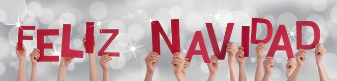 Ręki Trzyma Czerwonego Feliz Navidad Zdjęcia Stock