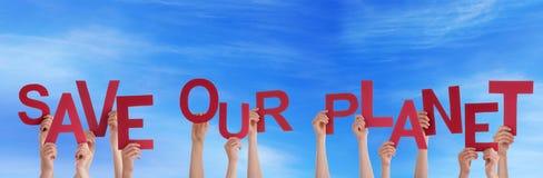 Ręki Trzyma Save Nasz planeta w niebie Zdjęcie Royalty Free