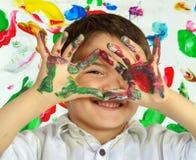 Ręki w farbie Zdjęcia Stock