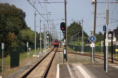 R-Net train on a single track which splits at the platforms of station Boskoop in the Netherlands between Gouda and Boskoop.  stock images