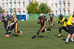 R. Pukhaev (11) dribble. RUSSIA, TROITSK CITY - JULY 11: Rodion Pukhaev (11) dribble on Russian american football Championship game Spartans vs Raiders 52 on Royalty Free Stock Image