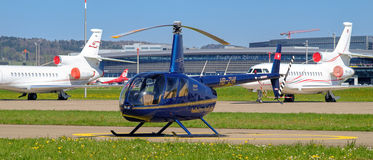 R44 Raven II Helicopter in the Zurich Airport Stock Images