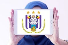 R.S.C. Anderlecht football club logo. Logo of Anderlecht football club on samsung tablet holded by arab muslim woman. Anderlecht is a Belgian professional Stock Image