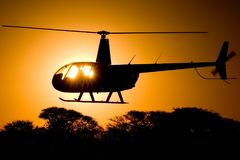 R44 Sunset. An Robinson R44 helicopter at sunset Royalty Free Stock Image