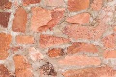 R?tt stena utomhus- bakgrund f?r v?ggen, och textur av dekorativt kritiserar stenen royaltyfri foto