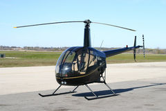 R22 helicopter. Black r22 Beta II helicopter Stock Image
