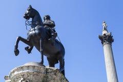 1ra estatua de rey Charles y columna de Nelsons en Trafalgar Square Imagenes de archivo