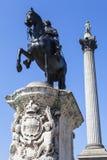 1ra estatua de rey Charles y columna de Nelsons en Trafalgar Square Imágenes de archivo libres de regalías