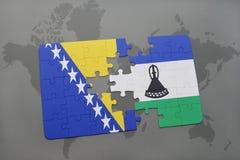 raadsel met de nationale vlag van Bosnië-Herzegovina en Lesotho op een wereldkaart Royalty-vrije Stock Afbeeldingen