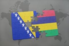 raadsel met de nationale vlag van Bosnië-Herzegovina en Mauritius op een wereldkaart Stock Foto's