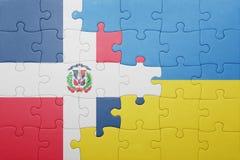 raadsel met de nationale vlag van de Dominicaanse republiek van de Oekraïne en Stock Foto's