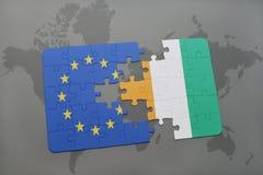 raadsel met de nationale vlag van Europese Unie en kooi divoire op een achtergrond van de wereldkaart Stock Afbeelding