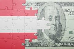 Raadsel met de nationale vlag van het bankbiljet van Oostenrijk en van de dollar Royalty-vrije Stock Fotografie