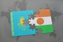 raadsel met de nationale vlag van Kazachstan en Niger op een wereldkaart Royalty-vrije Stock Foto's