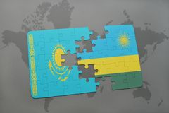 raadsel met de nationale vlag van Kazachstan en Rwanda op een wereldkaart Stock Fotografie