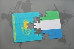 raadsel met de nationale vlag van Kazachstan en Sierra Leone op een wereldkaart Royalty-vrije Stock Afbeeldingen