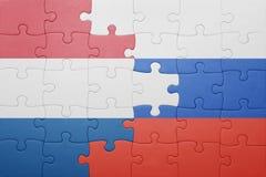 Raadsel met de nationale vlag van Nederland en Rusland Royalty-vrije Stock Afbeeldingen