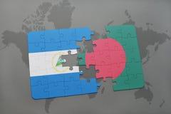 raadsel met de nationale vlag van Nicaragua en Bangladesh op een wereldkaart Stock Foto's