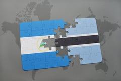 raadsel met de nationale vlag van Nicaragua en Botswana op een wereldkaart Stock Foto