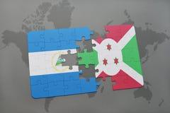 raadsel met de nationale vlag van Nicaragua en Burundi op een wereldkaart Stock Foto