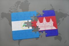 raadsel met de nationale vlag van Nicaragua en Kambodja op een wereldkaart Stock Foto's