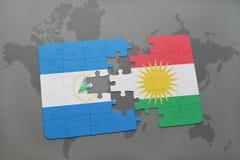 raadsel met de nationale vlag van Nicaragua en Koerdistan op een wereldkaart Royalty-vrije Stock Afbeelding