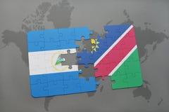 raadsel met de nationale vlag van Nicaragua en Namibië op een wereldkaart Stock Fotografie