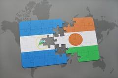 raadsel met de nationale vlag van Nicaragua en Niger op een wereldkaart Stock Foto