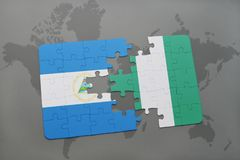raadsel met de nationale vlag van Nicaragua en Nigeria op een wereldkaart Stock Foto