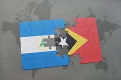 raadsel met de nationale vlag van Nicaragua en Oost-Timor op een wereldkaart Stock Afbeelding
