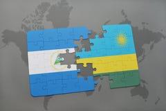 raadsel met de nationale vlag van Nicaragua en Rwanda op een wereldkaart Royalty-vrije Stock Foto's